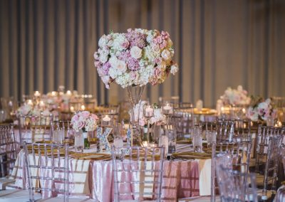 The tall table pieces were repurposed fro the ceremony with the bridal and bridesmaid bouquets added to this table for special family